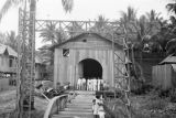 Philippines, people entering church in Kolambugan