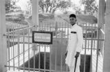 India, man in uniform standing at broken pillar of Ashoka in Varanasi