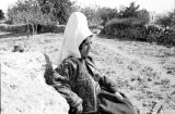 Israel, portrait of Arab girl sitting on hill near Bethlehem