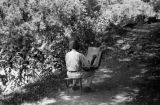 Philippines, man drawing picture near forest