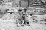 Jordan, portrait of children at Urn Tomb in Petra