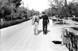Israel, British soldier and Western man walking in Haifa street