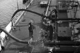Israel, sailors on deck of oil tanker in Haifa Bay