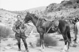 Jordan, portrait of Arab guard and his horse in Petra