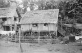 Philippines, native stilt houses with children at windows in Port Holland