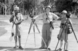 Singapore, men with cameras and camera equipment