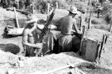 Laos, German soldiers preparing weapons for battle in Xiangkhoang