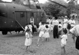 Malaysia, people surrounding British Royal Navy helicopter