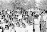 India, girls and Caucasian woman posing at school in Amalner