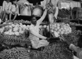 India, vendor weighing produce at Mahatma Jyotiba Phule (or Crawford) Market in Mumbai