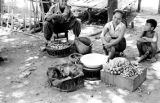 Laos, merchants selling produce on street