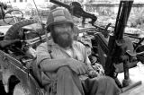 Laos, soldier resting in jeep at Xiangkhoang