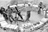 Laos, soldiers setting up mortar for battle in Xiangkhoang