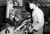 Taiwan, man operating machine at Civil Air Transport facility in Gaoxiong Gang