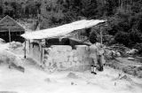 Malaysia, military personnel inspecting structure at Fort Telanok