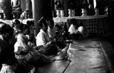 Myanmar, women worshipping at shrine in Rangoon