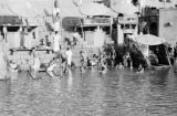 India, people bathing at ghat on Ganges River in Varanasi