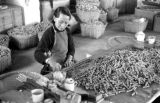 Macau, woman making fireworks at Kwong Hing Tai Firecracker factory