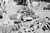 India, man shaping pot on wheel at pottery yard in Varanasi