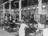 Singapore, factory workers inside opium plant