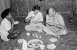 Indonesia, Harrison Forman eating meal with two men in Labuhanbajo