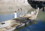 Basra (Iraq), closeup view of small cargo boat in canal