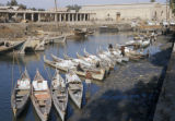 Basra (Iraq), row of small passenger boats lined up in canal