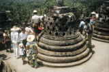 Indonesia, tourists taking in view from top of Borobudur Temple