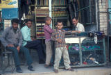 Ābādān (Iran), group of men and boys at a local store