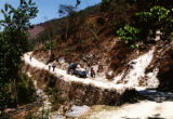 Nepal, men hauling rocks along roadside