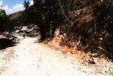Nepal, dirt road along the mountainside and dwellings