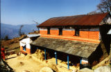 Pokhara (Nepal), building with mountains in background