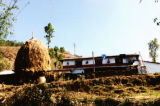 Pokhara (Nepal), house with haystack in front