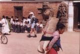 Bhaktapur (Nepal), woman carrying a rug on her back