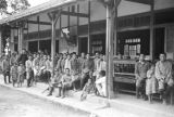 Taiwan, group of people sitting outside a school