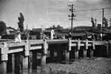 South Korea, people crossing bridge over Chonggye stream in Seoul