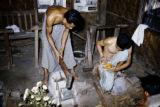 Myanmar, men making gold leaf