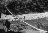 Taiwan, woman and child crossing a footbridge