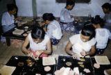 Myanmar, women making gold leaf