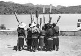 Taiwan, group of women holding carved staffs for pestle chant dance
