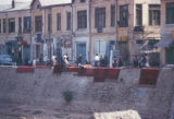 Kābul  (Afghanistan), street scene with rugs drying