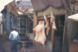 Kābul (Afghanistan), butcher shop with meat hanging