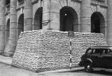 Hong Kong, sandbags stacked to protect a building from air raids on Jackson Road
