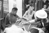 Hong Kong, group of men playing a game