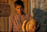 Cinarcik (Turkey), boy carrying loaves of bread