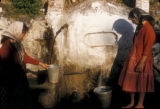 Cinarcik (Turkey), girls drawing water at the village fountain