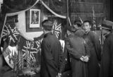 Shanghai (China), people looking at British and American flags in the British-controlled area, The...