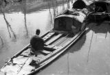 Shanghai (China), man sitting on a sampan