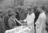 Shanghai (China), boy physician vaccinating a boy soldier