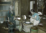 Japan, women spinning silk into rolls by hand